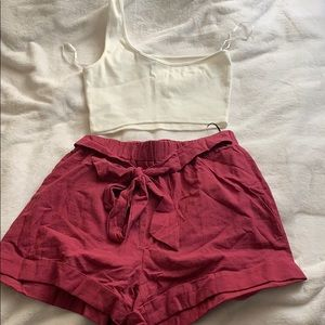 One shoulder crop top with self belted shorts
